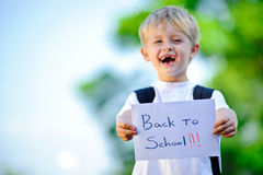 Child with paper sign Stock Image