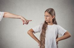 Child parent confrontation. Closeup portrait parent pointing at child in white t-shirt scolding go to room grounded for misbehaving while kid is looking Stock Photography