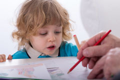 Child and parent drawing together Royalty Free Stock Image