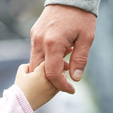 Child and parent holding hands. Closeup of a child and parent holding hands Royalty Free Stock Photos