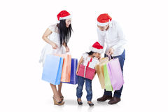 Child with parents looking at shopping bags Stock Image