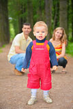Child with parents in park Royalty Free Stock Photo