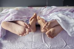 Child with parents sleeping together on the bed Royalty Free Stock Photography
