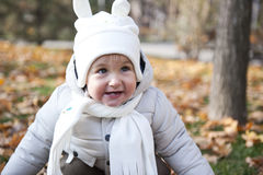 Child in the park. Portrait with happy little boy playing in the park in autumn Stock Image