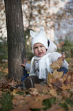 Child in the park. Portrait with happy little boy playing in the park in autumn Royalty Free Stock Images