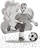 Child in a park runs happily,. Playing with his soccer ball Stock Images