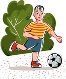 Child in a park runs happily,. Playing with his soccer ball Royalty Free Stock Photography
