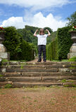 Child park steps arms raised. Child in park at top of stairs or steps with arms raised Royalty Free Stock Image