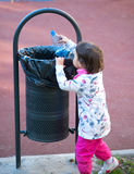 Child Participate In Recycling In The Park In Spring Time Stock Photos