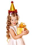 Child in party hat with gold gift box . Child in party hat with gold gift box on birthday. Isolated royalty free stock photography