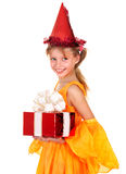 Child in party hat holding gift box. Royalty Free Stock Photos