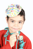 Child  with party hat and whistle. Smilling  boy with party hat and whistle Royalty Free Stock Images