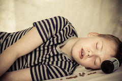 Child passed out from overdose of pills Stock Photography