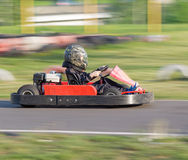 The child passes some turns on a go-cart in carting club Royalty Free Stock Photo