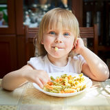 Child with pasta Stock Photo