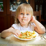 Child with pasta Stock Photography
