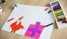 Child pastel drawing of Santa Claus and present. Wish list royalty free stock photo