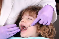 Child patient at the dentist. Dental examine royalty free stock image