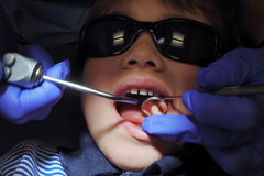 Child patient having her teeth examined by specialist dentist Stock Photos