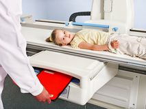 Child patient  in x-ray room. Royalty Free Stock Photo