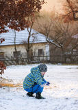 Child paying in snow iin winter Royalty Free Stock Photo