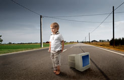 Child with pc Royalty Free Stock Image