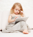 Child with pc at home Royalty Free Stock Photos