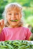 Child with peas Stock Photography