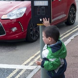 Child a pedestrian crossing. Child pressing a button on pedestrian crossing Stock Photo