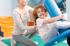 Child on pediatric swing. Child swinging on pediatric swing during sensory integration session Stock Images