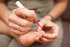 Child pedicure and nail polish Stock Photo