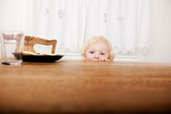 Child Peeking Over Table Royalty Free Stock Photos