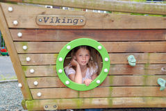 Child peeking through porthole Royalty Free Stock Photo