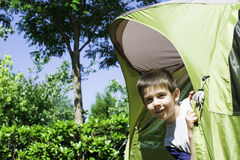 Child peeks from a tent Stock Image