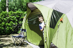 Child peeks from a tent Stock Photos