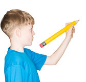 Child with a pencil in hand Royalty Free Stock Photography