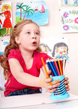 Child  with pencil in play room. Royalty Free Stock Photo