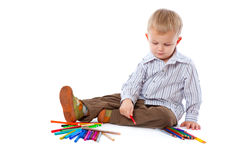 Child with pencils Royalty Free Stock Photos