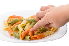 Child and penne pasta Royalty Free Stock Images
