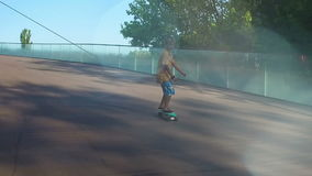 Child on a pennyboard, flares, slow motion stock video footage