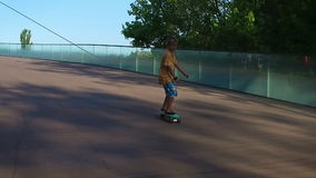 Child on a pennyboard, slow motion stock video footage