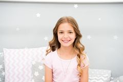 Child perfect curly hairstyle looks cute. She use conditioner or mask with organic oils to keep hair shiny and healthy. Beauty salon tips. Girl child with long royalty free stock image