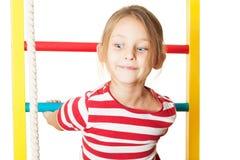 Child performs gymnastic exercise Stock Photos