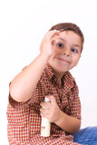 Child with perfume. Litle boy with perfume on the white background Royalty Free Stock Photos