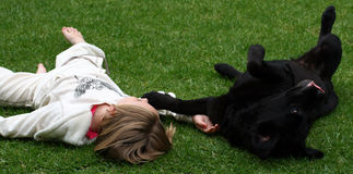 Child and pet royalty free stock photography