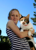 Child and pet. A white caucasian girl child holding her cat pet Royalty Free Stock Photos
