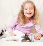 Child with pet at home Royalty Free Stock Image