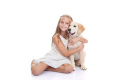 Child with pet puppy dog. Child hugging pet labrador retriever puppy dog Royalty Free Stock Images