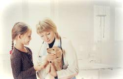 Child, pet on reception to vet Stock Image