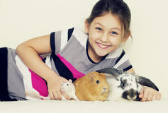 Child and pets Stock Photos